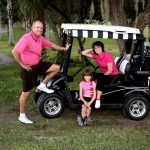 family with golf cart daytona beach by cooper photography