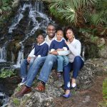 beautiful african american family portrait outdoors by waterfall cooper photography