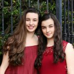 brunette sisters dressed in red by iron gate cooper photography